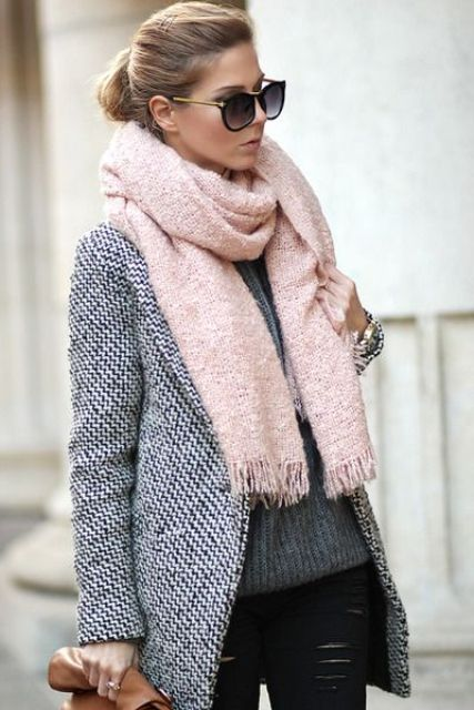 With distressed pants, gray sweater, brown clutch and gray coat