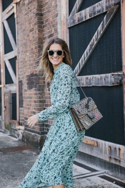 With floral midi dress and sunglasses