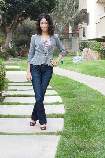 With floral shirt, flare jeans and cutout shoes
