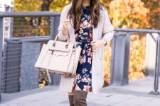 With gray cardigan, beige bag and gray over the knee boots