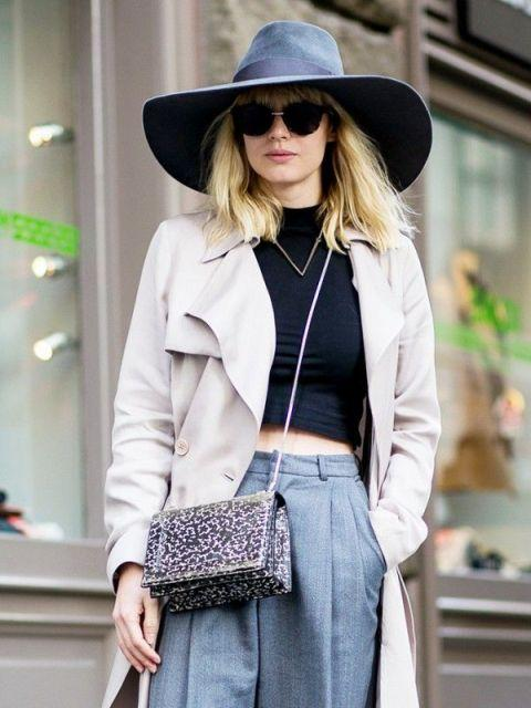 With gray hat, black crop top, beige coat and gray trousers