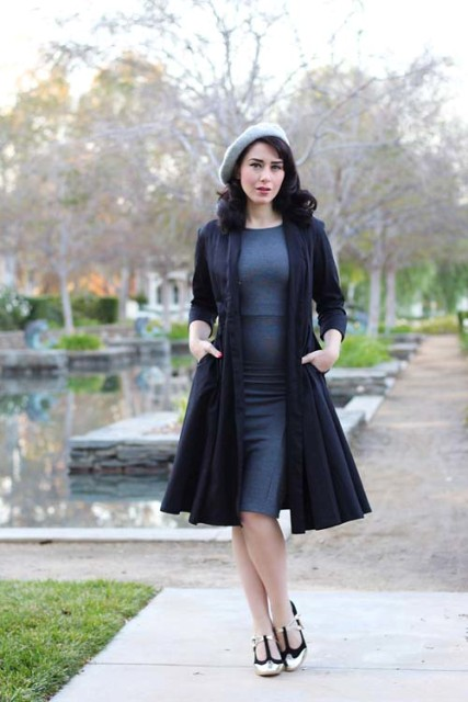 With gray knee-length dress, gray beret and black and golden shoes