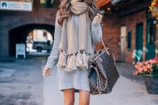 With gray mini dress, printed tote bag and suede high boots