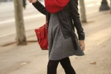 With gray mini dress, red bag, high heeled boots and black leather jacket