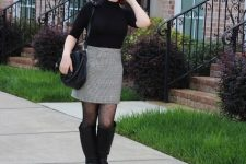 With gray skirt, black beret, black bag and black high boots