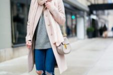 With gray sweater, pale pink coat, gray chain strap bag and gray pumps