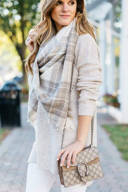 With gray sweater, white pants and plaid scarf