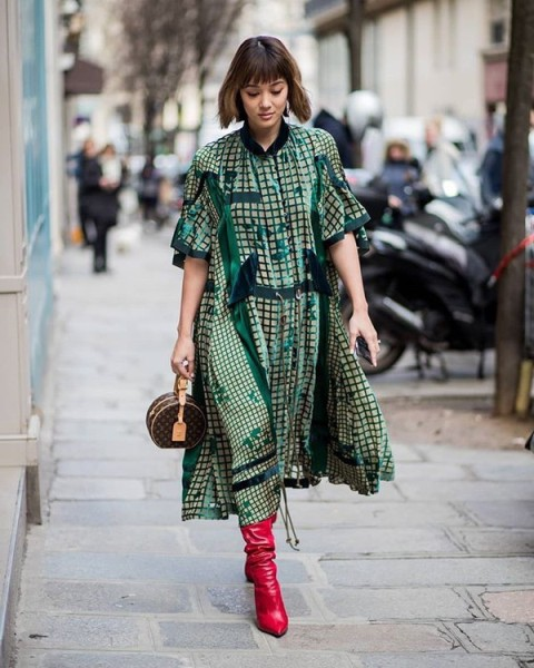 With green printed oversized dress and printed bag