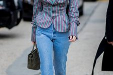 With jeans, brown boots and gray bag