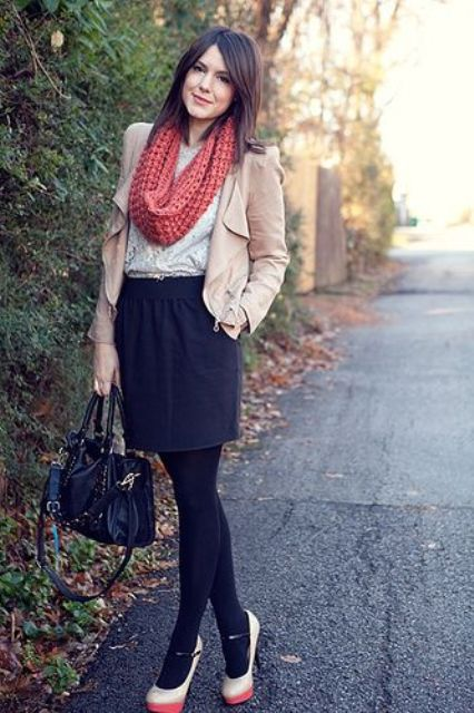 With lace blouse, mini skirt, high heels, beige jacket and black bag