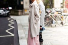 With light gray coat, sunglasses and platform shoes