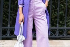 With lilac coat, shirt, white bag and beige high heels