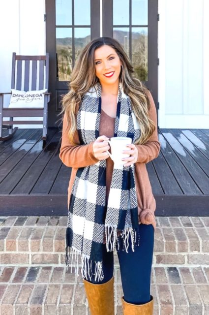 With loose sweater, navy blue jeans and mustard yellow over the knee boots