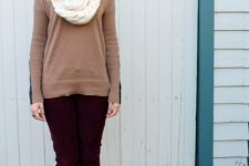 With marsala pants, brown leather high boots and light brown sweater