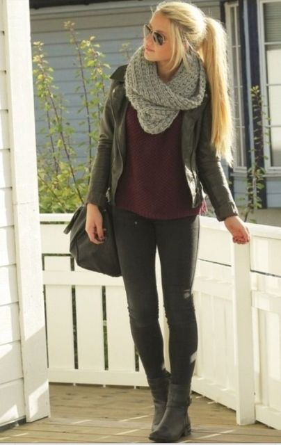 With marsala sweater, black leather jacket, black tote bag, skinny pants and mid calf boots