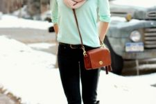 With mint green sweater, black trousers, black and brown high boots and brown bag