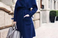 With navy blue midi coat, cropped jeans, white turtleneck and gray tote bag