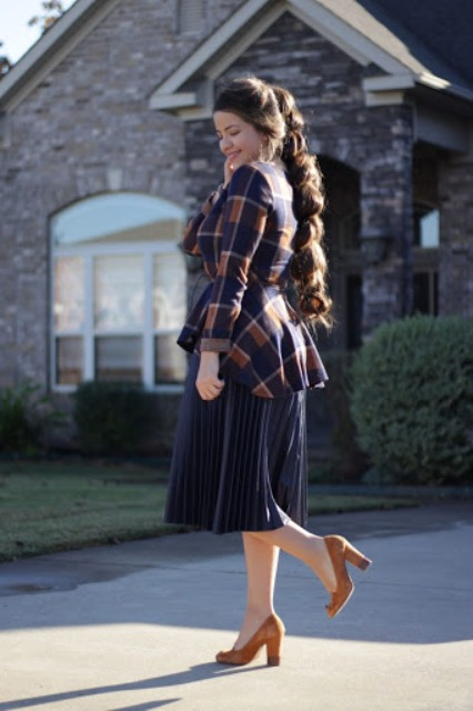 With navy blue pleated skirt and brown shoes