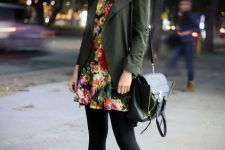 With olive green jacket, black tights, black high heel boots and bag