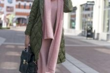 With pale pink midi dress, olive green coat, hat, black bag and lace up boots