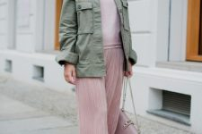 With pale pink shirt, olive green jacket, chain strap bag and white sneakers
