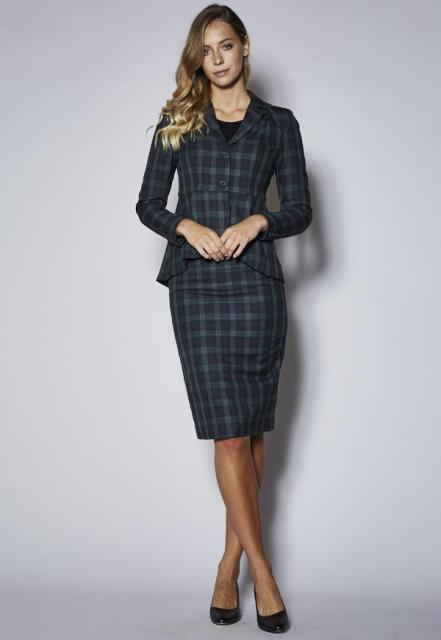 With pencil skirt, black top and black pumps