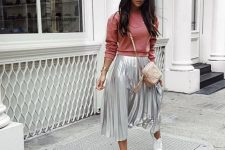 With pink sweater, beige tassel bag and white sneakers