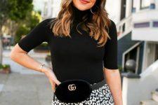 With printed midi skirt, black waist bag and sunglasses