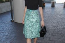 With printed skirt, black flat shoes and mini bag