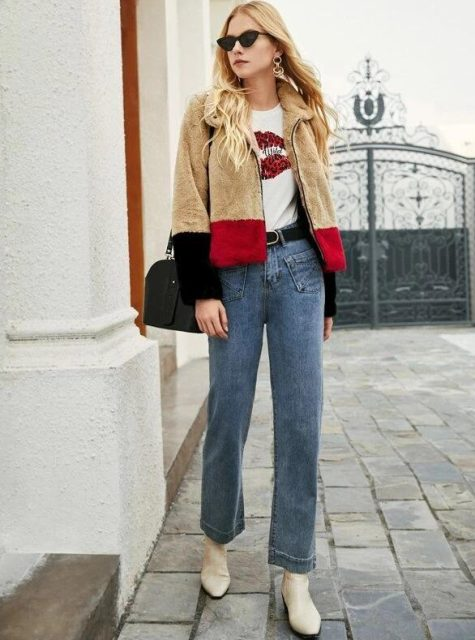 With printed t shirt, loose jeans, black bag and white flat boots