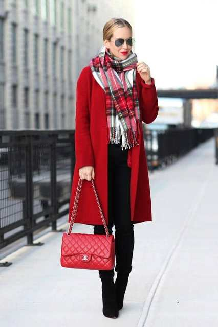 With red coat, chain strap bag, black cuffed trousers and black ankle boots