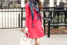 With red mini dress, white bag and two colored pumps