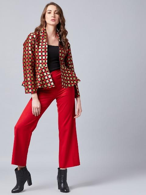 With red pants, black top and black ankle boots
