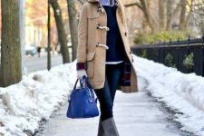 With shirt, black sweater, navy blue jeans, gray high boots and cobalt blue bag