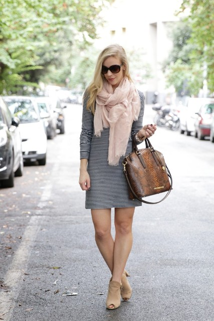 With striped mini dress, bag and beige cutout boots