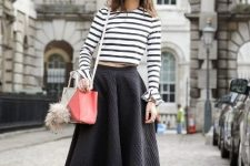 With striped shirt, A-line skirt and white and pink bag