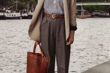 With striped shirt, beige cardigan, brown tote bag and brown shoes