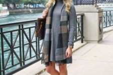 With sweater dress, printed tote bag and black fringe boots