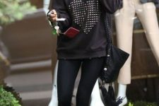With sweatshirt, black leggings, bag and sunglasses