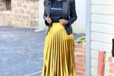 With t-shirt, black jacket and black pumps