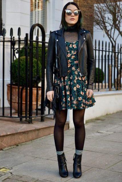With transparent shirt, black jacket, fringe bag and black boots