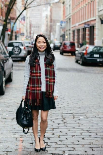 With turtleneck, mini skirt, black bag and shoes