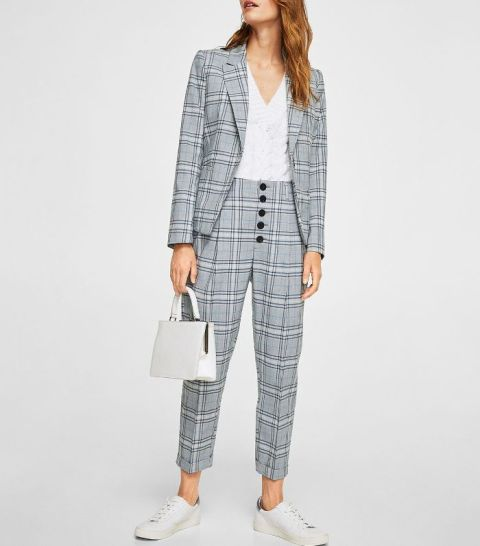 With white V neck shirt, gray checked blazer, white bag and white sneakers