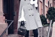 With white bell sleeved blouse, black trousers, black lace up boots and embellished bag