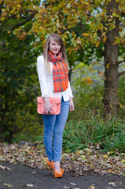 With white blazer, skinny jeans, pale pink clutch and orange high heels