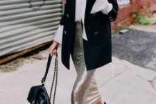 With white blouse, black long blazer, backpack and black ankle boots