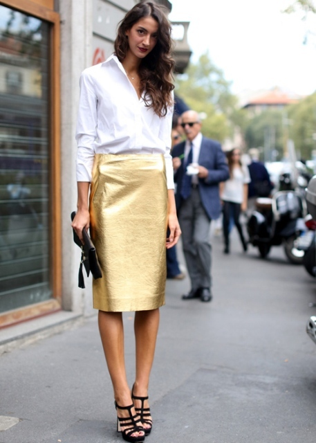 With white button down shirt, black clutch and high heels