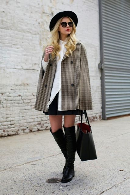 With white button down shirt, black hat, black skirt, tote bag and high boots