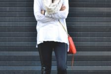 With white cardigan, black leather leggings, red bag and colorful sneakers