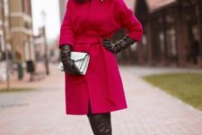 With white clutch, black leather gloves and over the knee boots
